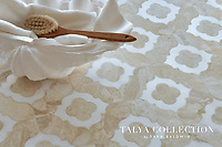 Irene, a stone waterjet mosaic shown in Snow White and Diana Royal, is part of the Talya Collection by Sara Baldwin for Marble Systems.