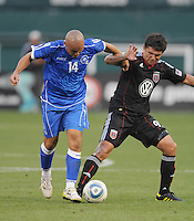 DC United Forward Jaime Moreno (99) battles for possession of the ball against EL Salvador National Team midfielder Dennis Alas (14).  DC United defeated El Salvador National Team 1-0 in a international charity match at RFK Stadium, Saturday June 19, 2010.