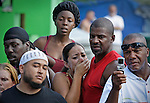 "Nadia Asencio and Paul Morrow, at center, reacts to watching the fighting on September 18, 2010. Dhafir Harris, ""Dada 5000"", puts on backyard fights at his mother house, which go viral on youtube and have been the subject of documentaries. Sometimes the men fight until they are unconscious. There' s no gloves and occasionally, there's a cage. The community has taken to the events, because they are able to set up businesses selling food and washing cars."