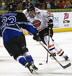 - Council Bluffs, IA. 4/29/2003 River City Lancer Nick Schaus tries to maneuver the puck around Lincoln's JESSE LINDENBERG at the Mid America Center Tuesday evening (Chris Machian/Prairie Pixel Group)