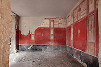 Large room adjoining the service room, decorated with frescoes in the Fourth Style of Roman wall painting, 60-79 AD, in the Fullonica di Stefanus, or Fullonica of Stephanus, a laundry in Pompeii, Italy. Above a black frieze decorated with plants and birds are red panels separated by architectural elements, and above, architectural motifs on a white background. Pompeii is a Roman town which was destroyed and buried under 4-6 m of volcanic ash in the eruption of Mount Vesuvius in 79 AD. Buildings and artefacts were preserved in the ash and have been excavated and restored. Pompeii is listed as a UNESCO World Heritage Site. Picture by Manuel Cohen