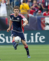 New England Revolution midfielder Stephen McCarthy (26) passes the ball. In a Major League Soccer (MLS) match, DC United defeated the New England Revolution, 2-1, at Gillette Stadium on April 14, 2012.