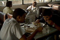 An elderly man and other diners in the Indian Coffee House, Baba Kharak Singh Marg, New Delhi.