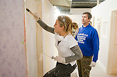 Painting & Decorating student applies paint with a brush, Able Skills, Dartford, Kent.