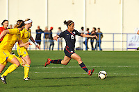 Casey Noguiera fires off a pass away from the Swedish defense.  The USA was victorious over Sweden 2-0 in Ferreiras on March 1, 2010 at the Algarve Cup.
