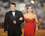 Senior maid A. J. Haupt (left) is escorted by Kent Hill during Lafayette High vs. Byhalia in homecoming football action in Oxford, Miss. on Friday, September 24, 2010.