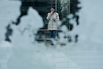 United States, New Jersey. A woman enjoys a cigarette after the pass of the nor'easter winter storm from Exchange Place in New Jersey. 08/11/2012. Photo by Eduardo Munoz Alvarez / VIEWpress.