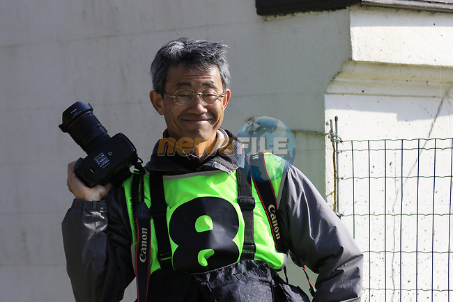 Photographer Yuzuru Sunada at the top of the Taaienberg 18% cobbled climb during the 60th edition of the Record Bank E3 Harelbeke 2017, Flanders, Belgium. 24th March 2017.<br /> Picture: Eoin Clarke   Cyclefile<br /> <br /> <br /> All photos usage must carry mandatory copyright credit (&copy; Cyclefile   Eoin Clarke)