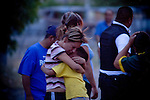 Family members react near the scene of the shooting of a 15 year-old boy, who was killed by a U.S. Border Patrol agent in Ciudad Juarez, Chihuahua on June 7, 2010 after he had tried to cross.