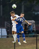 Winthrop University Eagles vs the Brevard College Tornados at Eagle's Field in Rock Hill, SC.  The Eagles beat the Tornados 6-0.  Rhem Stubbs (31) and Pietro Bottari (21) contest a header.