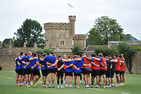 The Bath Rugby squad huddle together at the end of the session. Bath Rugby training session on August 4, 2015 at Farleigh House in Bath, England. Photo by: Patrick Khachfe / Onside Images