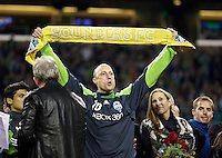 Seattle Sounders FC goalkeeper Kasey Keller holds up a golden scarf against the San Jose Earthquakes at CenturyLink Field in Seattle Saturday October 15, 2011. The Sounders FC won the game 2-1. The game was Keller's last regular season home game.