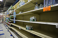 "Bare shelves because of Hurricane Sandy at a supermarket in the Battery Park City evacuation zone inNew York on Sunday, October 28, 2012. In advance of the arrival of Hurricane Sandy New York will down the subways at 7 PM on Sunday and evacuate low lying ""Zone A"" areas including Battery Park City. In addition the schools will be closed on Monday. (© Richard B. Levine)"