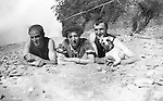 North East PA:  View of Brady, Clark and Peppy Stewart along with Aunt Margaret Stewart Gray laying on the rocky shore of Lake Erie.