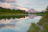 Path to reflection. A foot path along the Oxbow Bend of the Snake River leads the eye into the photo.  Sunrise at Oxbow Bend in Grand Teton National Park