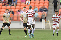 Houston, TX - Friday December 11, 2016: Adrian Alabi (17) of the Stanford Cardinal heads the away from Brad Dunwell of the Wake Forest Demon Deacons at the NCAA Men's Soccer Finals at BBVA Compass Stadium in Houston Texas.