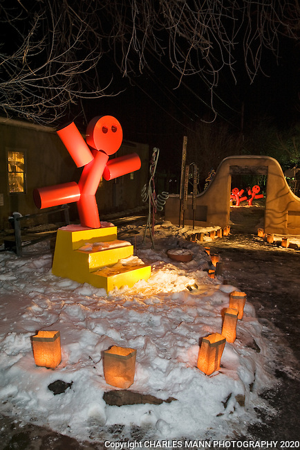 Even the art work seems to participate in the festivities during the annual Christmas Eve celebration on Canyon Road in Santa Fe,New Mexico