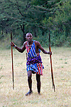 Africa, Kenya, Masai Mara. Maasai Warrior demonstrates hunting and archery skills for visitors to Cottar's 1920's safari Camp.