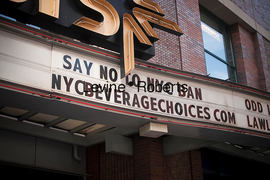 A marquee on a movie theater in Brooklyn in New York on Saturday, September 8,m 2012 protests against New York Mayor Michael Bloomberg's plan to regulate the size of soft drinks sold in the city. The mayor's proposal would prohibit food establishments that the city licenses from selling high calorie drinks such as cola in containers larger than 16 ounces. (© Richard B. Levine)