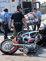 A man is wheeled away after a motorcycle accident on Piedmont Avenue in Atlanta.