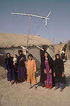 Marsh Arabs. Southern Iraq. Circa 1985. Marsh Arab women and children outside their adobe home with TV aerial banks of River Tigris...