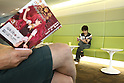 July 27, 2010 - Tokyo, Japan - People read in a waiting room at the Akihabara Blood Donation Center in Tokyo, Japan, on July 27, 2010. Also called 'Akiba:F', the blood donation facility opened on October 2009 and has free wifi, figure display cases, shelves of manga, and video screens that will show movies, to help people relax and feel comfortable.