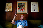 Former Chicago Cardinals football player Charley Trippi was inducted into the College Football Hall of Fame and the Pro Football Hall of Fame during his career in the sport. He points to a painting of himself that he received from a prisoner in 1947. He poses in his Athens, Georgia home. KENDRICK BRINSON