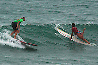 Saturday, June 14, 2008, Tourmaline Surf Park, Pacific Beach, San Diego, CA, USA.  Erin Lewis (Left) and Mele Saili pass one another during the womens final of the Pacific Beach Surf Club's Tenth Annual Longboard Classic at Tourmaline Surfing Park.  Saili went on to win the event and Lewis placed second.  The event was well attended despite gray, June gloom clouds and fickle, windy surf conditions.