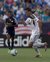 Philadelphia Union forward Sebastien Le Toux (9) dribbles at midfield. In a Major League Soccer (MLS) match, the Philadelphia Union defeated the New England Revolution, 3-0, at Gillette Stadium on July 17, 2011.