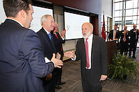 NWA Democrat-Gazette/DAVID GOTTSCHALK   John Tyson (center), chairman of the board for Tyson Foods, is greeted after speaking Thursday, February 9, 2017, before a dedication ceremony for Springdale's new Don Tyson School of Innovation campus. The school is named after Donald Tyson former chairman and chief executive officer of Tyson Foods. Half of the campus opened in August, with construction wrapping up on the other half in time for this semester.