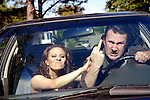 """Scott and Sloane Warren in their car. The couple recently penned their first script, """"Drove,"""" a comedy about car culture that will be performed at Atlanta's Dad's Garage Theatre."""