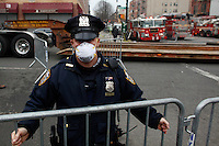 A NYPD officer blocks the access to the street after than a powerful explosion knocked two residential buildings in East Harlem killing 2 people and injuring at least 22 others in New York. March 12, 2014. Photo by Eduardo Munoz Alvarez/VIEW