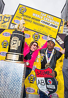 Oct 30, 2016; Las Vegas, NV, USA; NHRA top fuel driver Antron Brown celebrates after clinching the 2016 NHRA top fuel world championship as wife Billie Brown celebrates with the check during the Toyota Nationals at The Strip at Las Vegas Motor Speedway. Mandatory Credit: Mark J. Rebilas-USA TODAY Sports