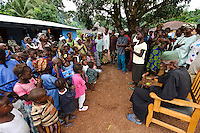 Children and adults singing at Maboraba Village, nr Makeni, Sierra Leone. Planting Promise is an organization dedicated to the development of education in Sierra Leone. Its aim is to bring opportunities to initiate self-run, self-supporting projects that offer real solutions to the difficulties facing the world's poorest country. They believe real and lasting development comes from below, from local projects that address specific needs, rather than large international models. To this end, they currently run five projects that aim to bring wealth into the country through business. The profits from these businesses are then used to support free education for children and adults...Through the combination of business with social progress, the charity hopes that they are providing real, lasting and profound changes for the better, by promoting sustainable and beneficial industry in the country, and putting it to the service to the needs of the people. As well as providing the income to fund the school, the farms will also be an example of successful commercial enterprise to teach the children in the school the viability of profit-making schemes that go beyond subsistence models, the only things the children of these desperately poor areas are accustomed to. By learning particular details of the challenges that they will face, the children will emerge from this school equipped to contribute in a real way to their society.