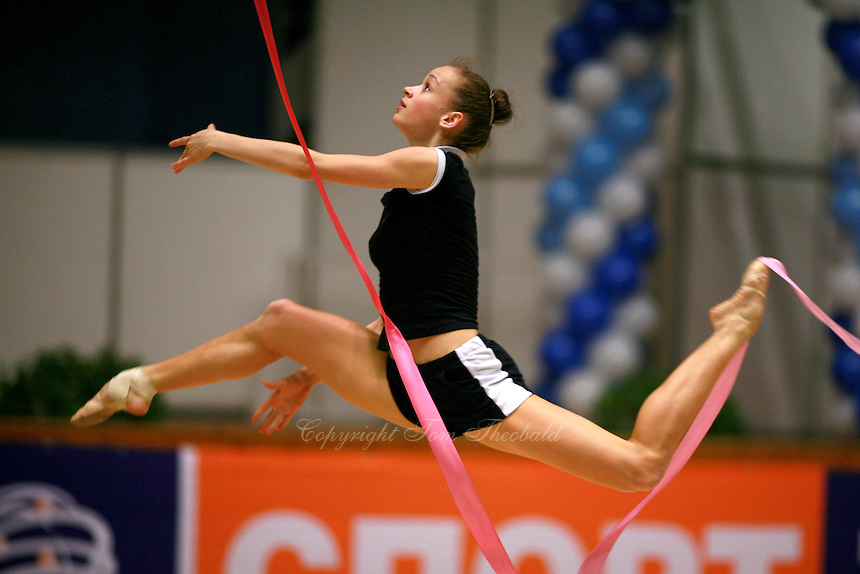 Marina Shpekt of Russia split leaps to re-catch ribbon routine during training before Burgas Grand Prix Rhythmic Gymnastics on May 5, 2006.  (Photo by Tom Theobald)