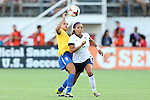 10 November 2013: Sydney Leroux (USA) (2) and Calandrini (BRA) (left). The United States Women's National Team played the Brazil Women's National Team at the Citrus Bowl in Orlando, Florida in an international friendly soccer match. The U.S. won the match 4-1.