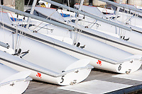 A fleet of double-handed Club 420 sailing dinghies sit docked on Spa Creek in Annapolis, Maryland.