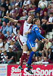 Hearts v St Johnstone...14.08.10  .Kevin Kyle clashes heads with Murray Davidson which left him after to leave the field fro treatment to a cut above the eye.Picture by Graeme Hart..Copyright Perthshire Picture Agency.Tel: 01738 623350  Mobile: 07990 594431