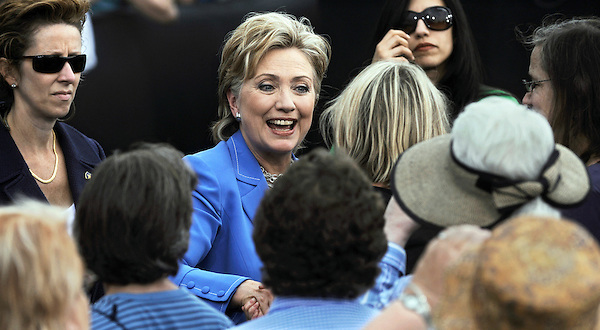 Unity, New Hampshire: June 27, 2008.Former presidential candidate Hillary Clinton, a Democrat, greets people at the conclusion of a campaign rally dubbed 'Unite For Change.' The event featured herself and her formal rival presidential candidate. The woman wearing sunglasses at right is Huma Abedin, Clinton's traveling chief of staff. The woman wearing sunglasses at left is a Secret Service special agent.  ©Christopher Fitzgerald / CandidatePhotos.com