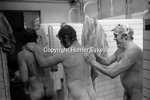 Miners showering.  South Kirkby Colliery, Yorkshire England. Coal Miners story 1979. Miners are from L-R.  Unknown, Brian Greenhough, Mick Armytage. Mick and Brian were officials at Kirkby.