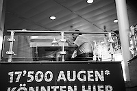Switzerland. Canton Solothurn. Günzgen. Marché Günzgen Sud on the Highway A1. An employee from the Marché restaurant takes a break and reads news on his mobile phone. 12.02.17 © 2017 Didier Ruef