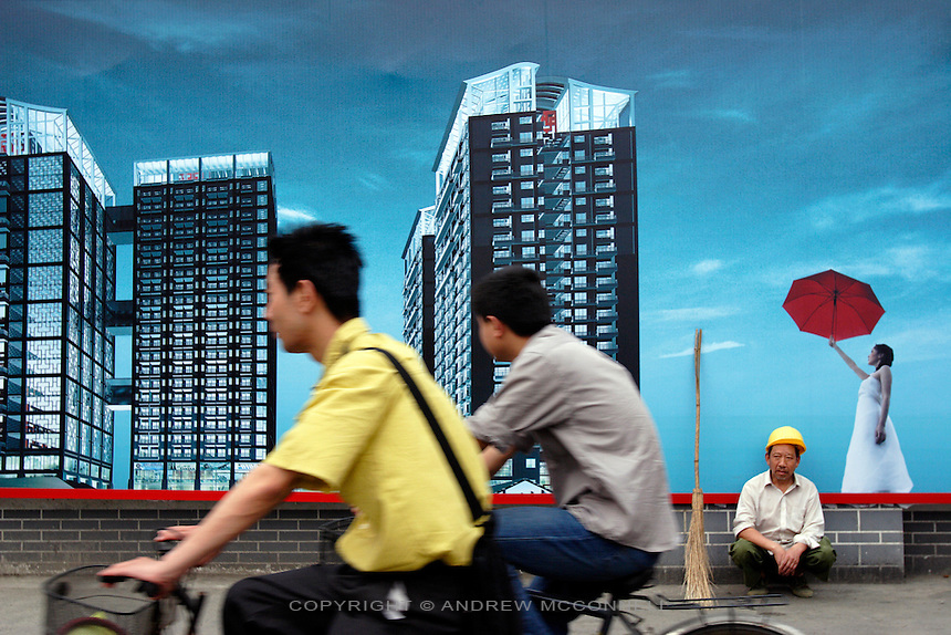 A labourer rests outside a construction site in Chengdu, Thursday, Apr. 28, 2005. As part of China's Go West campaign massive construction projects are transforming the city.