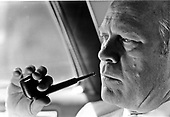 Super close-up study of United States President Gerald R. Ford with a pipe in his hand as he rides to the White House in his limousine in Washington, D.C. on August 11, 1974.<br /> Mandatory Credit: David Hume Kennerly / White House via CNP