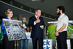 Yvo de Boer, executive secretary of the UNFCCC, speaks with Ben Margolis, campaigns managers for TckTckTck. TckTckTck presented an alarm clock to Mr. de Boer at the Barcelona Climate Talks to show how civil society is waking up and urging leaders to do the same. Members of 350.org hold photos of the actions that took place on Oct. 24 in the background.  (©Robert vanWaarden ALL RIGHTS RESERVED)