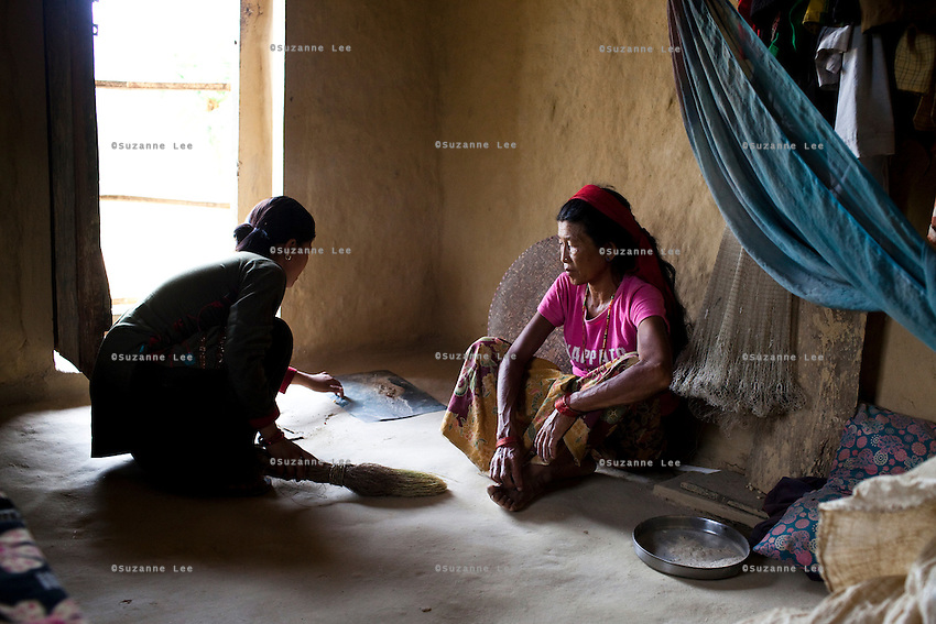 Nisha Darlami, 19, does the housework in her mother's (right) house in Kalyan Village, Surkhet district, Western Nepal, on 30th June 2012. Nisha eloped with her step nephew when she was 13 but the couple used contraceptives for the next 6 years to delay pregnancy until she turned 18. In Surkhet, StC partners with Safer Society, a local NGO which advocates for child rights and against child marriage. Photo by Suzanne Lee for Save The Children UK