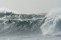 Jetski in big waves during the Quiksilver Eddie Aikau at Waimea Bay on the Northshore of Oahu in Hawaii