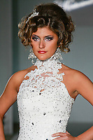 Model walks the runway in a Cinderella wedding dress by Katerina Bocci during the Wedding Trendspot Spring 2011 Press Fashion, October 17, 2010.