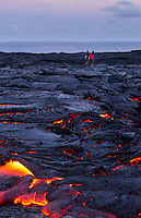Two women start their long hike back after viewing the lava flow in Hawai'i Volcanoes National Park, Hawai'i Island.