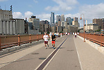 Minnesota, Twin Cities, Minneapolis-Saint Paul: Stone Arch Bridge crosses Mississippi at Minneapolis.  Former railroad bridge now used for recreation. .Photo mnqual260-75181..Photo copyright Lee Foster, www.fostertravel.com, 510-549-2202, lee@fostertravel.com.
