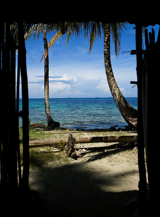 Looking through the bamboo hut to the beautiful waters surrounding Isla Pelikano, San Blas Islands, Kuna Yala, Panama